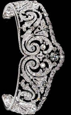Cartier Scroll Tiara, c.1910  Platinum, one cushion-shaped diamond, round old-cut diamonds Millegrain setting. Exhibition El Arte de Cartier Madrid
