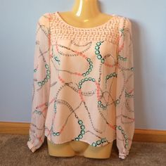 Candie's Pink Necklace Top Pale pink top with lace detail at the top. The design with the necklaces is blue, green, pink and grey in color. Chiffon-like material. Excellent condition only worn once Candie's Tops Tees - Long Sleeve