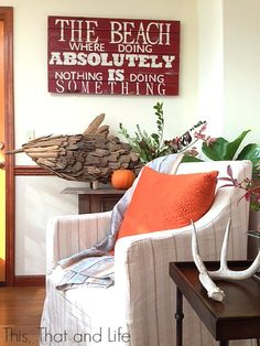 All you need is a few pops of orange (and a tiny pumpkin!) and your beach house is ready for fall!