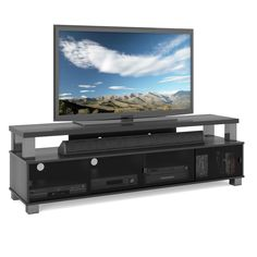This two-tiered TV bench helps you create a great home theater area as it showcases your flat-screen TV and provides convenient space for your audio equipment and more. Tinted tempered glass doors hide your electronic equipment, creating a clean look.