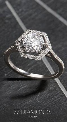 This #Round #Diamond center stone look #magnificent with a diamond band and hexagon #halo! #Launched #today #77Diamonds #Halo #Engagement #Ring #Collection
