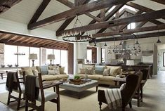 This Texas hill country retreat is a bright and open family getaway by Shiflet Group Architects, located in the Frio cañon community along the Frio River. Hill Country Homes, Texas Hill Country, Houses Architecture, Decoration Chic, Transitional Living Rooms, Wood Beams, Home Living, Kitchen Living, Rustic Kitchen