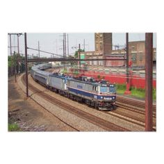 Amtrak AEM-7 910 Leading a Northeast Direct Train Print - Amtrak AEM-7 910 Leading a Northeast Direct Train. Running north at Frankford Jct. Philadelphia PA. Electro-Motive Division built 65 of the Electric Locomotives between 1978 and 1988. Photo by Stan Feldman 7/17/2001