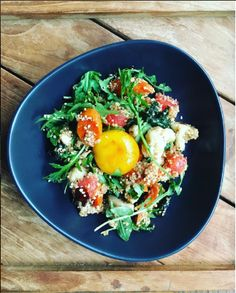 Fluffy quinoa provides the spine, but vegetables star in this healthy and  super-delicious dish: Cauliflower for crunch, arugula for its peppery bite;  with juicy ripe tomatoes and lime combining with egg yolks to make a lush  dressing.  Make sure you buy plain quinoa—not the flavored stuff.