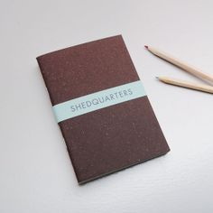 gorgeous set of three handmade A6 notebooks, brown, yellow and a marbley white one