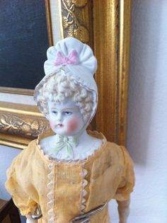 Antique Parian China Head Doll RARE Bonnet Version ohhh I have her shes one of my very few antiques most of mine are repro. got her for 5.00 at a auction when some big mouth dealer loudly proclaimed it was not a doll but a broken statue head stuck in a cloth doll body..right sure