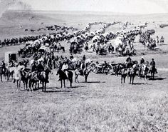 Cavalry, wagons and artillery led by General Custer as they cross the plains of the Dakota Territory.