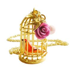 Birdcage necklace. Features a vintage birdcage with a tiny enamel-finish bird inside- on a gold chain. Embellished with a golden swallow, pearls, and a resin rose. @ http://www.temporary-secretary.com/