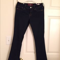 Lucky Brand Charlie Baby boot dark blue jeans Beautiful darkest blue Lucky jeans .. Baby boot cut so mostly skinny but a little boot cut at the bottom .. Super slimming and leg lengthening.. Your legs look so good, so skinny and long.. Size 2 or 26. Only worn once excellent condition! Beautiful with boots or pumps or ballet flats or wedges in the summer .. Lucky Brand Jeans Boot Cut