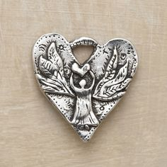 """GUARDIAN HEART CHARM--Jes MaHarry inscribes her guardian angel heart charm with a suitable sentiment: """"Someone to watch over me.""""-For Jacob and Lizzie??"""