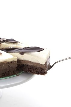 Creamy dreamy low carb white chocolate mousse atop dark chocolate mousse and a grain-free chocolate cake.