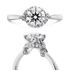 """Hearts on Fire """"Optima"""" complete engagement ring with round brilliant center diamond and halo in 18k white gold."""