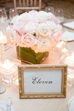 Gold framed table numbers and pale pink blooms spell out classic elegance at @Four Seasons Resort Palm Beach.