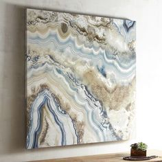 Agate stones are characterized by the fineness of their grain and bright colors. We think our painting on cotton canvas captures that beautifully through the use of marine and tan hues. Hang this natural beauty in your living room, bedroom or family room.