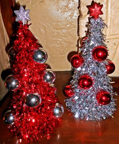 Dollar Tree Christmas Trees- Buy the tinsel trees at the Dollar Tree and the star ornaments  and ball ornaments and hot glue them really easy and look pretty
