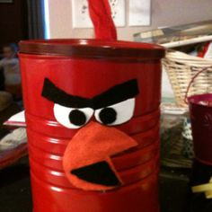 Coffee can, red spray paint, felt, and feathers!!!! This could be my son's valentines day box! Super easy!
