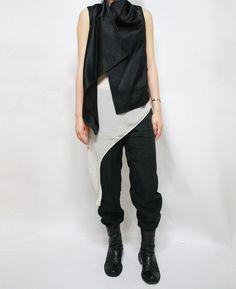 Vest: ANN DEMEULEMEESTER Top: ZARA Pants: ALEXANER WANG Boot: GOER