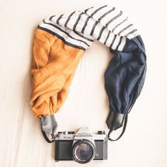 The VC Scarf Camera Strap    This scarf camera strap is the perfect accessory for any camera and photographer. Classy, fun and different.  $36 Etsy