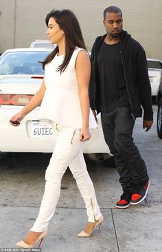 i am in love with KK's new street style…its a little more laid back and wearable then her SKIN TIGHT Pencil skirts…I am loving the shiny jeans simple t's or tanks and pumps!! kim kardashian and Kanye West