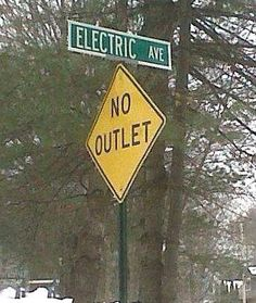 This appeals to my sense of irony. No outlet on Electric Avenue? How shocking! Instead, take the detour over to Battery Drive. Funny Street Signs, Funny Road Signs, Fun Signs, Dad Jokes, Funny Jokes, Hilarious Sayings, Hilarious Animals, 9gag Funny, Funny Laugh