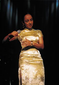 British Singer Sade in Gold Chinese Dress Chinese Dress Cheongsam, Chinese Dresses, Sade Adu, Neo Soul, 20th Century Fashion, Oriental Fashion, Timeless Beauty, Classic Beauty, Black Beauty