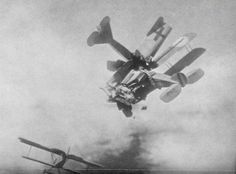 A British 'Bristol' and a German 'Fokker' colide in mid-air during a dogfight, World War I.