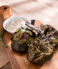 Eating artichoke leaves is definitely a hands-on experience: break them off one by one and draw through your teeth to enjoy the soft base of the leaf.
