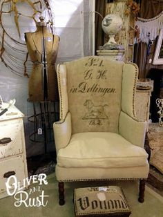 Use antique or vintage linens to Reupholster an old wing back chair