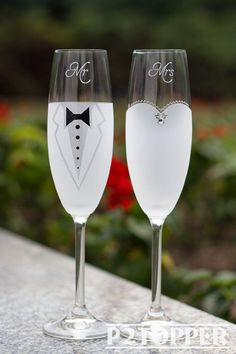 Set of two Glasses Price includes pair of champagne glasses and custom engraving. MEASUREMENTS: - Champagne flutes: Height - 9 inch (23 sm). Volume – 220ml (7.3 oz) - Used Material - Glasses, Swarovski Crystals, Pearls, acrylic paints We use sandblasting to create a deep, permanent