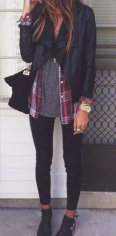 Leather jacket/ pitch black trousers/ gold watch & bracelets/ handbag/ black shoes/ plaid shirt