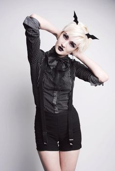 ahh! the outfit, the bat wings in the hair, the black lipstick. please.