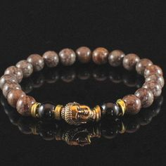 This men's Buddha mala meditation bracelet is made with Garnet and Snowflake Jasper. A mala is a strand of beads, traditionally used for counting during mantra meditations. Malas can consist of 108 be