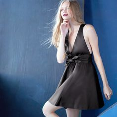 Little black dress, big style points. Try one with unexpected details like a plunging neckline and an oversized bow.