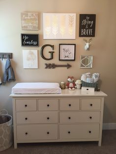 Neutral nursery, baby boy, gender neutral nursery, woodland nursery, white, gold, wood. Tribal nursery. Gallery Wall. Fox nursery.