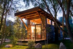 """Aptly named """"The Wedge,"""" this chic cabin features large windows to create the appearance of open space. Wheelhaus also builds all its tiny homes on wheels, allowing buyers the option of mobility with their small dwellings. Because of this fun feature, The"""