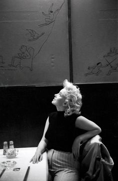 Marilyn admiring the cartoons on the wall, drawn by celebrated The New Yorker writer and cartoonist James Thurber, at Costello's restaurant on E. 44th Street. | 31 Candid Photos Of Marilyn Monroe In New York