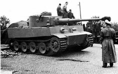 501 sPzAbt, Fallingbostel - Germany railway station, 10/1942. It s PzKpfw VI Tiger 1 ausf. H initial and Fgst this tank is 250014. This abteilung was sent to Tunesia in 11/1942