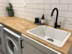 Wooden bench top, subway tiles and matte black tapware in our laundry Wooden Kitchen Bench, Kitchen Benches, Wooden Bathroom, Bathroom Black, Kitchen Interior, Kitchen Decor, Kitchen Design, Laundry Room Inspiration, Yellow Bathrooms