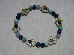 Stretch bracelet with 4 & 6mm gemstone rounds in shades of blue and turquoise (6 colors) and 6 silverplate milgrained hamsa bead frames.
