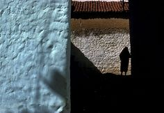 harry gruyaert(1941- ), morocco. rif mountains. chechaouen. street life in the rif mountains. Walls are often painted in blue and white. 1986. http://www.magnumphotos.com/C.aspx?VP3=SearchDetail&VBID=2K1HZOQWH65J9Z&PN=3858&IID=2TYRYDXUZZKK