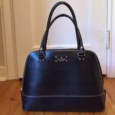 Kate Spade Wellesley Rachelle Large Purse SIZE 10.''h x 13.6''w x 5.1''d. drop length: 8''. Purse has a white film on the bottom (shown in picture) and there is a stain on the inside pocket from a lipgloss that spilled out. kate spade Bags Shoulder Bags