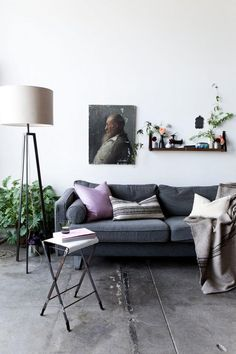 Curio shelf  White walls with portraiture and plants  Nicole Franzen encore - desire to inspire - desiretoinspire.net