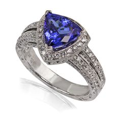 We love a brilliant tanzanite! And that is exactly what this ring features. Made of 18 karat white gold and holding 0.85 carats of diamonds, the center of attention here is a fiery 2.36 carat trillion shaped tanzanite!