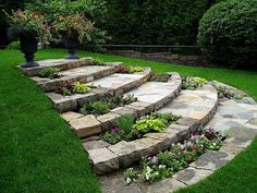 Flagstone steps with built in flower beds   and floating steps made out of flagstone. By Rainbow Landscaping