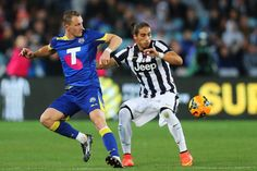 Besart Berisha of the All Stars competes with Martin Caceres of...