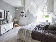Dreamy bedroom with light grey walls