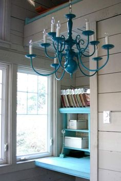 find an old brass or whatever chandelier or similar light fixture at a thrift store, paint and hang in home office.