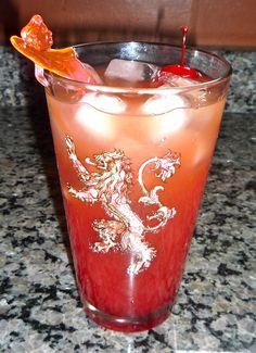 Impjuice: light rum, dark rum, spiced rum, orange juice, cranberry juice, and a little grenadine