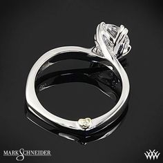 The Mark Schneider Beloved Solitaire Engagement Ring uniquely twists the boundaries of a traditional solitaire setting and blends them with artistic flowing lines that twirl around the diamond of your choice #Whiteflash