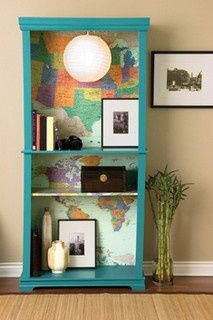 Bookshelf with map background. Love the idea! I would just go with a vintage map and Cherry, Espresso or a Dark wood.